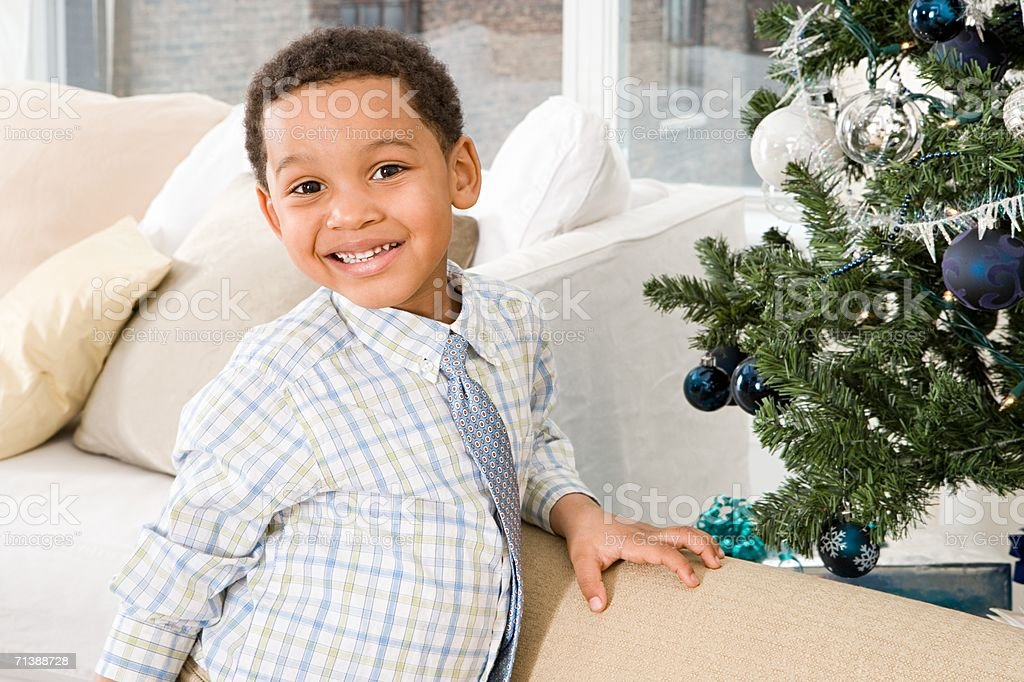 Young boy by Christmas tree royalty-free stock photo