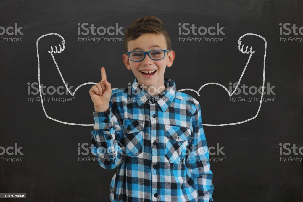 Young boy child blackboard growth confidence strong biceps muscle sport stock photo