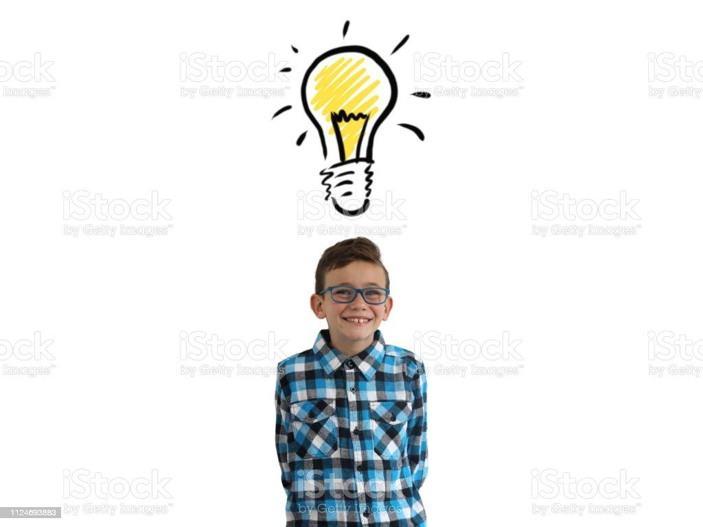 Young boy child think creative bright idea light bulb innovation isolated stock photo