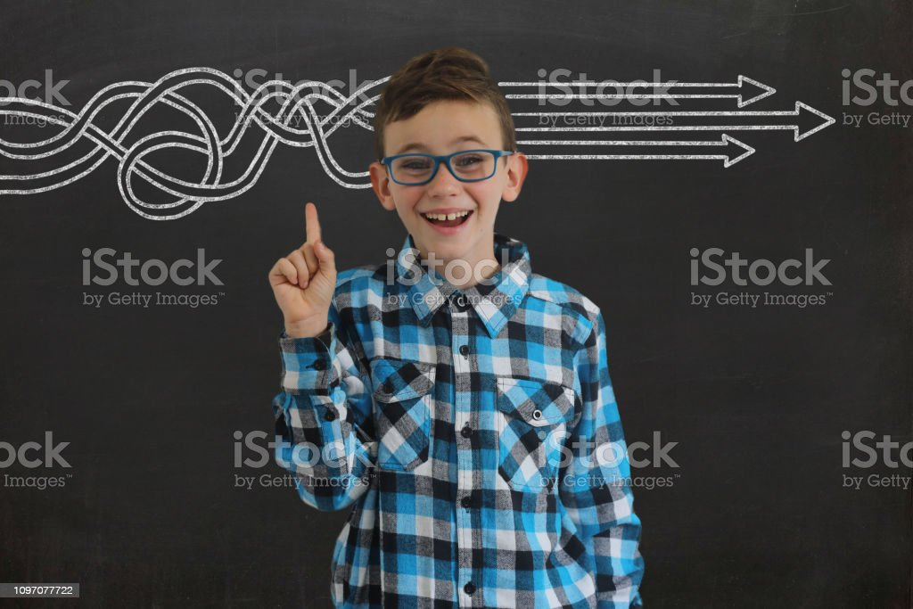 Young boy child think idea business strategy decision solution target blackboard stock photo