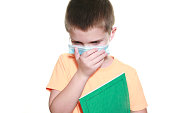 istock Young Boy Coughing Wearing Face Covering 1285650877