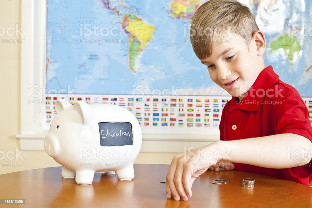 Young Boy Counting His Money, Saving for Education Concept stock photo