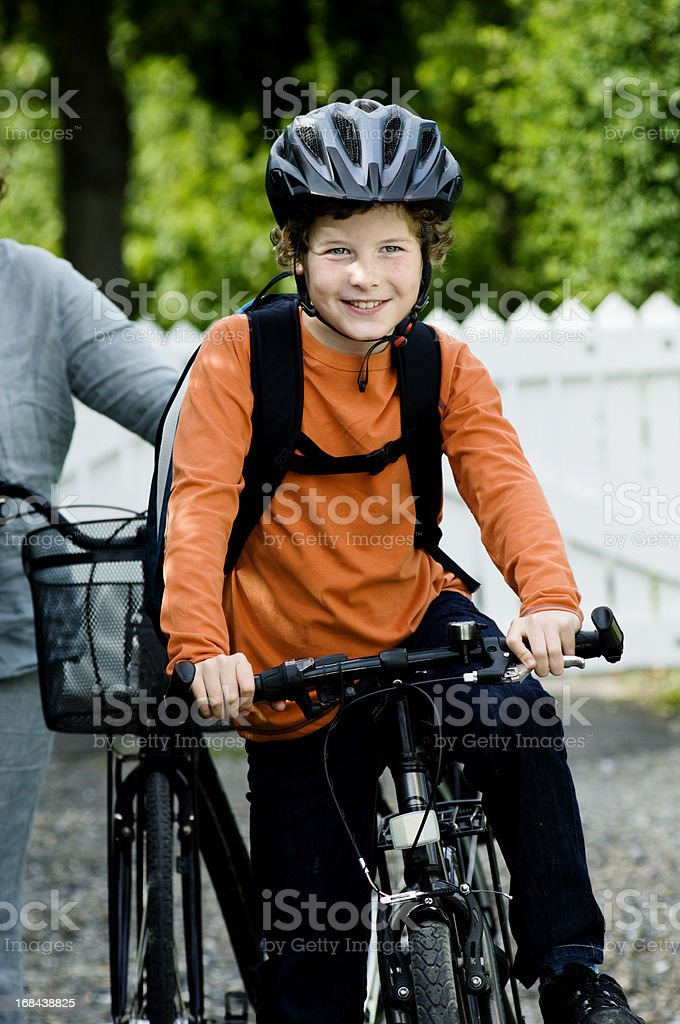 Young Boy Cycling Off To School stock photo