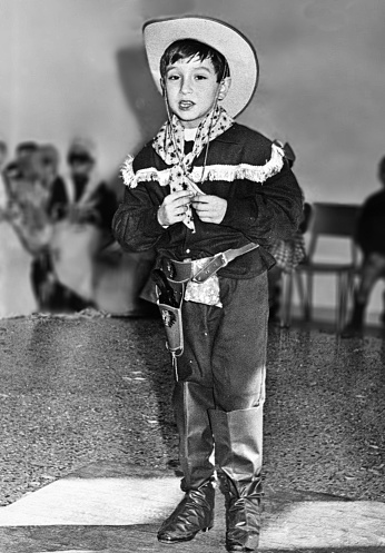 Young boy dressed as cowboy in 1963