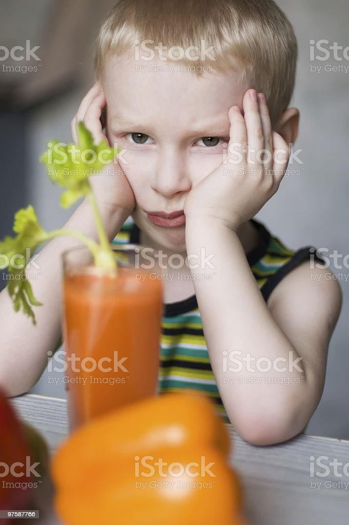 young boy doesn't like vegetables royalty-free stock photo