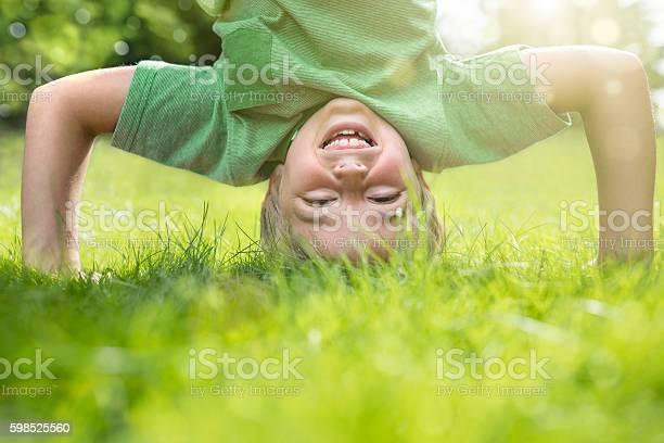 Young boy doing a headstand on the grass picture id598525560?b=1&k=6&m=598525560&s=612x612&h= fqs8szb0vsi4t ogijhvzpy7uslfzcj9iav8v00oog=