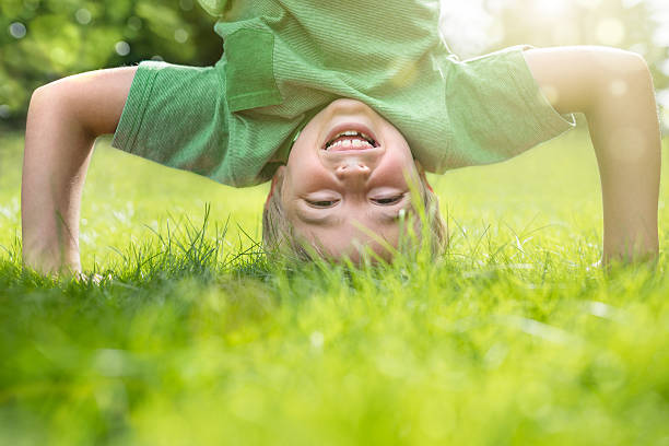 Young boy doing a headstand on the grass picture id598525560?b=1&k=6&m=598525560&s=612x612&w=0&h=ez3s0sv0ahgcm4u3mxjmfflo cbixfss3ze1f c9zvs=