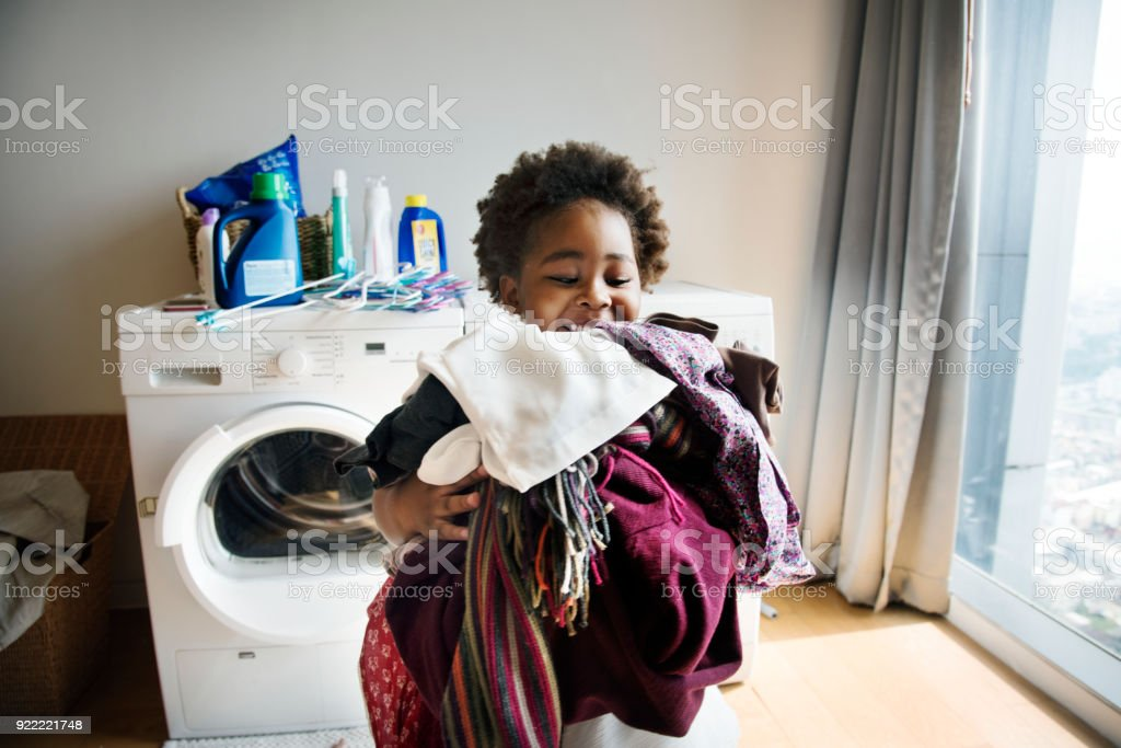 Young boy doing housework at home stock photo