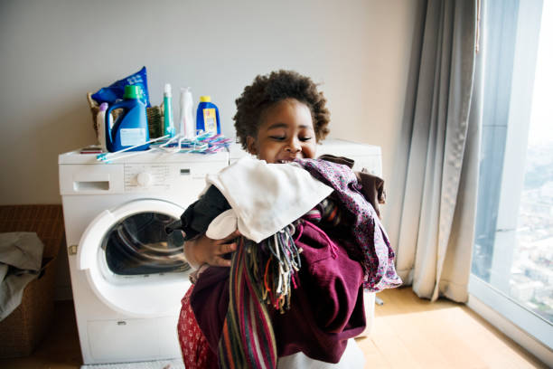 young boy doing housework at home - household chores stock photos and pictures