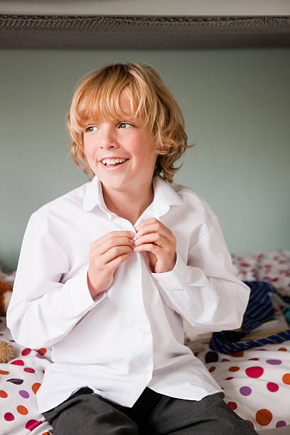 Kid Unbuttoned Shirt Stock Photos, Pictures & Royalty-Free