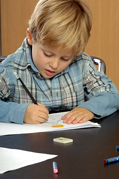 Young boy drawing stock photo