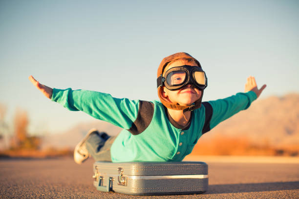 young boy dreams of air travel - dreamlike stock photos and pictures