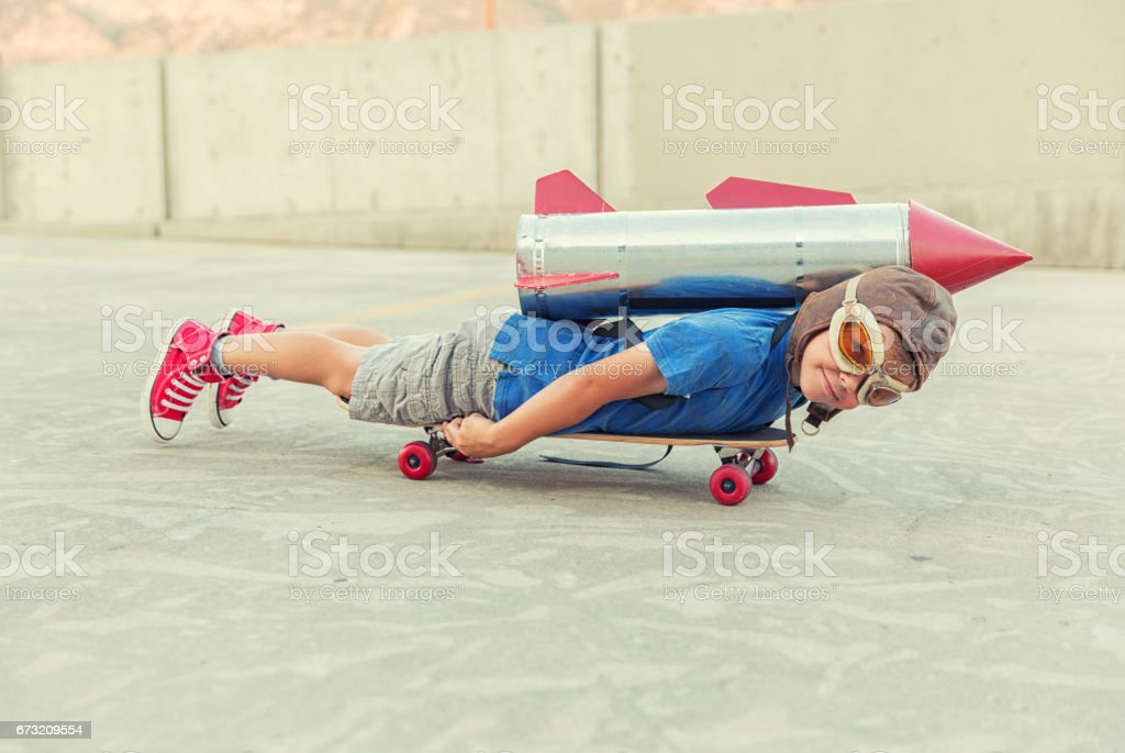 Young Boy Dreams of Flying with Rocket stock photo