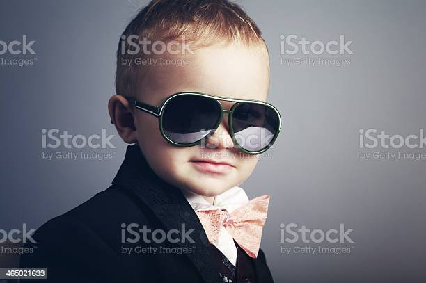 Young boy dressed as a gentleman with sunglasses picture id465021633?b=1&k=6&m=465021633&s=612x612&h=xhaksypwdjvuqiropryx zp gb5nqaxacsodytfipvo=