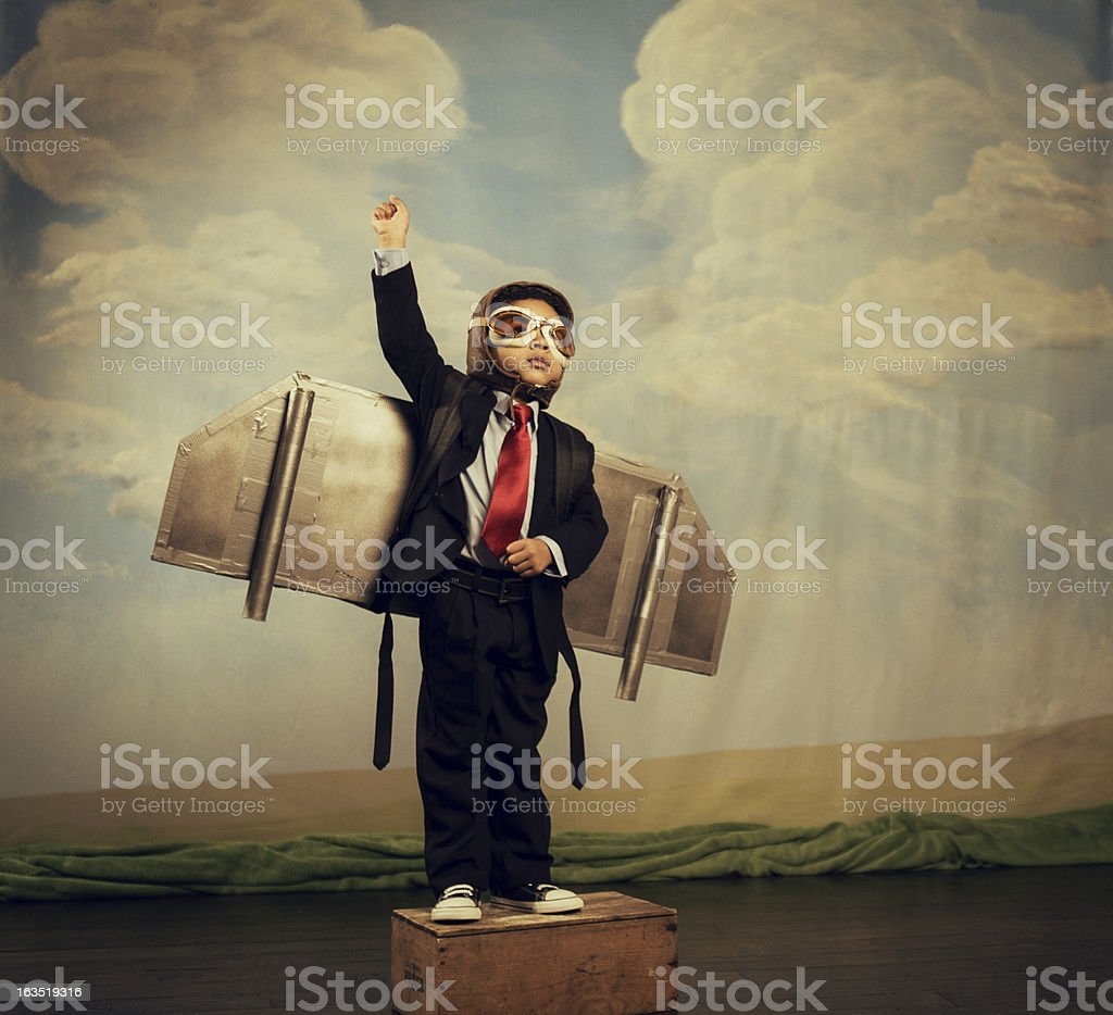 Young Boy dressed as Businessman Wearing Jet Pack stock photo