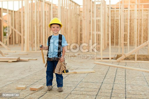 527687520 istock photo Young Boy dressed as Carpenter with Hardhat and Tools 508949730