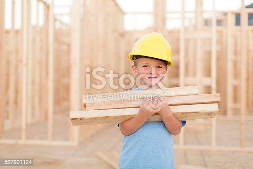 istock Young Boy dressed as Carpenter with Hardhat and Tools 527901124