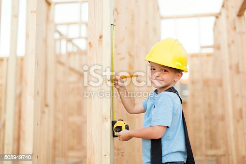 527687520 istock photo Young Boy dressed as Carpenter with Tape Measure 508949740