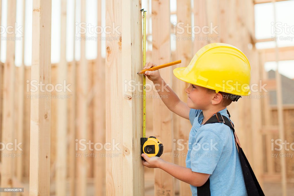 Young Boy dressed as Carpenter with Tape Measure stock photo