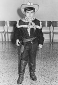 Young boy dressed as cowboy in 1953