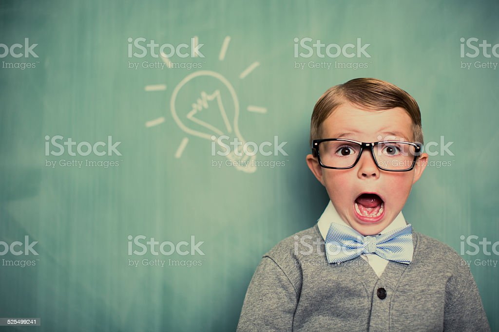 Young Boy Dressed as Nerd Has Big Idea stock photo