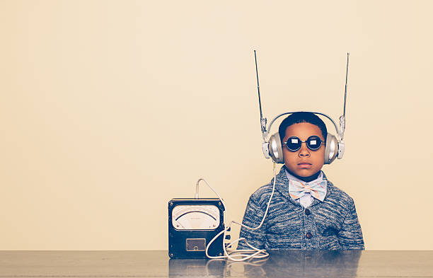 young boy dressed as nerd with alien headphones - genius stock photos and pictures