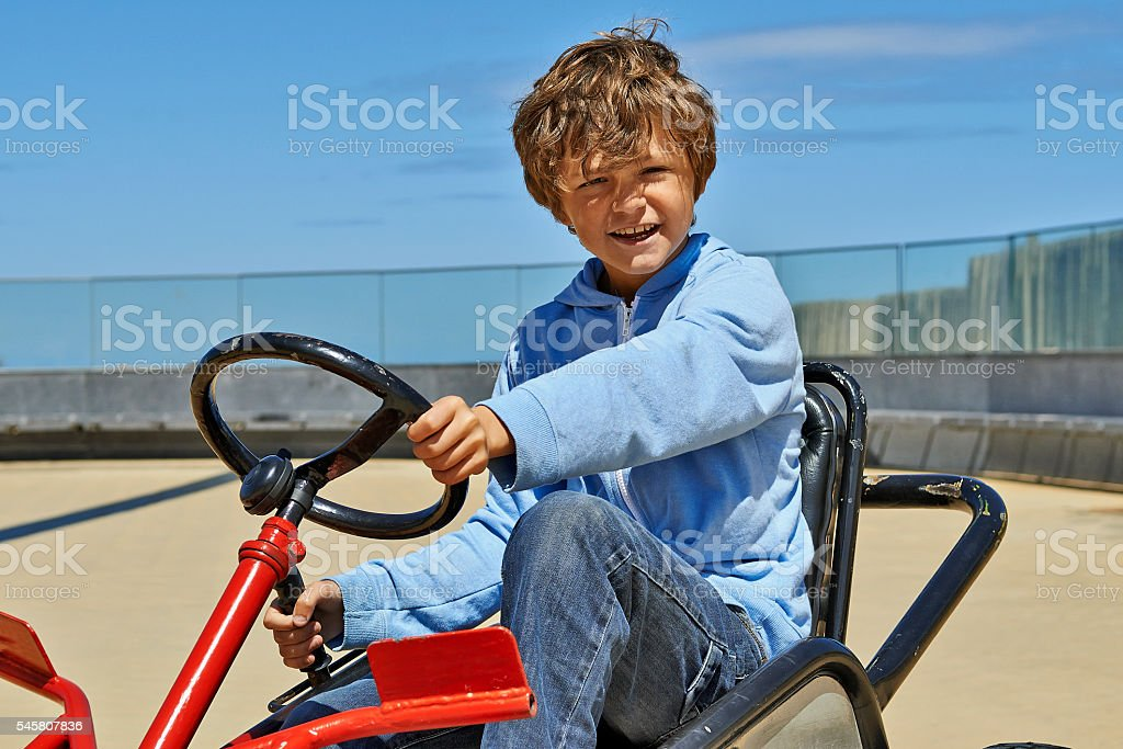 Young boy driving a Quadricycle foto