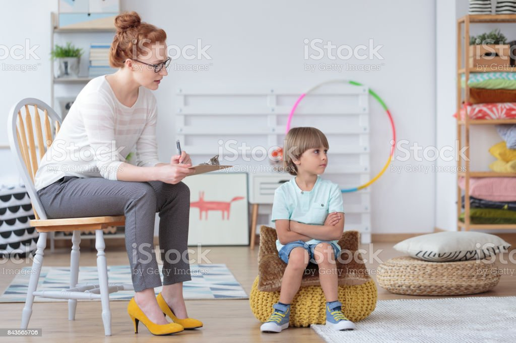 Young boy during psychotherapy session stock photo