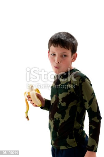 Young Boy Eating A Banana Stock Photo & More Pictures of Banana