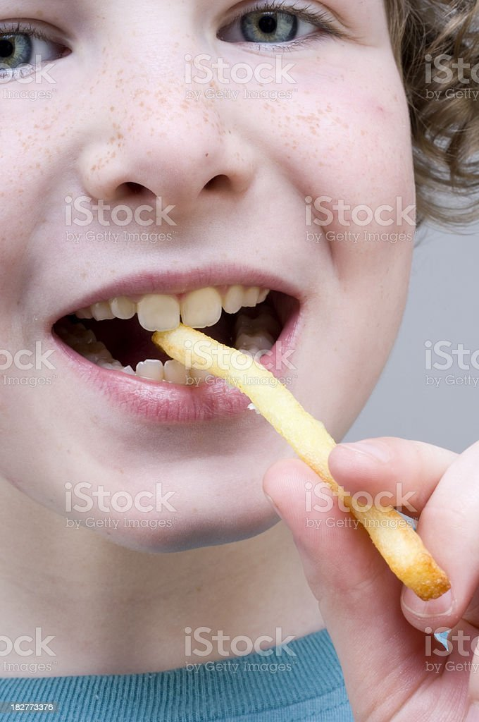 Young Boy Eating Chips stock photo