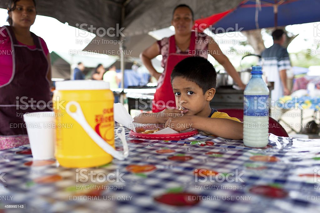 Young boy eating tacos royalty-free stock photo