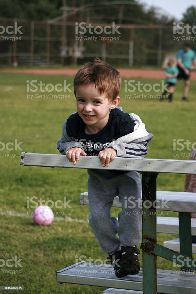 Young boy enjoying a soccer game royalty-free stock photo