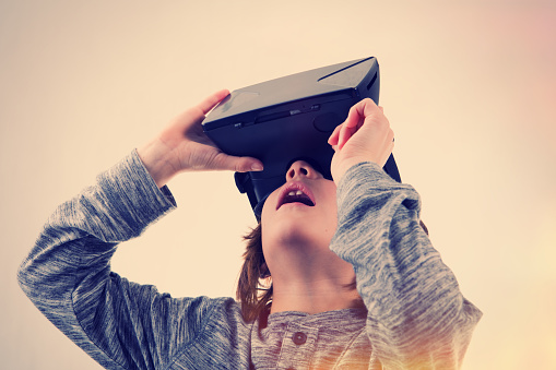 Young Boy Experiencing Virtual Reality Stock Photo - Download Image Now