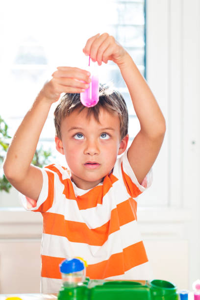 young boy experiments with colors stock photo