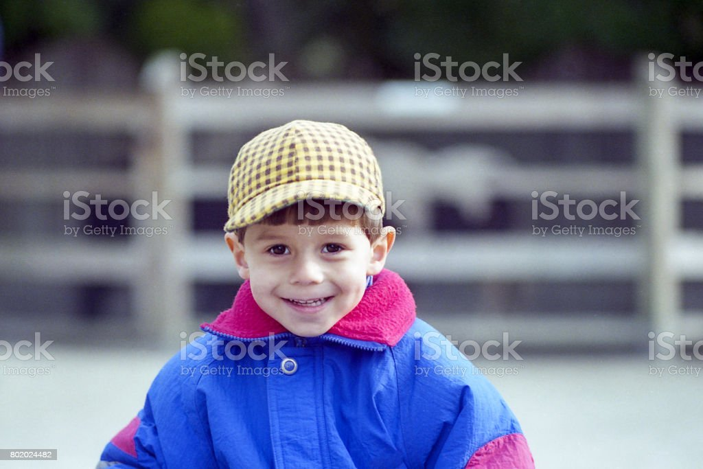 Young Boy Exploring Petting Zoo stock photo