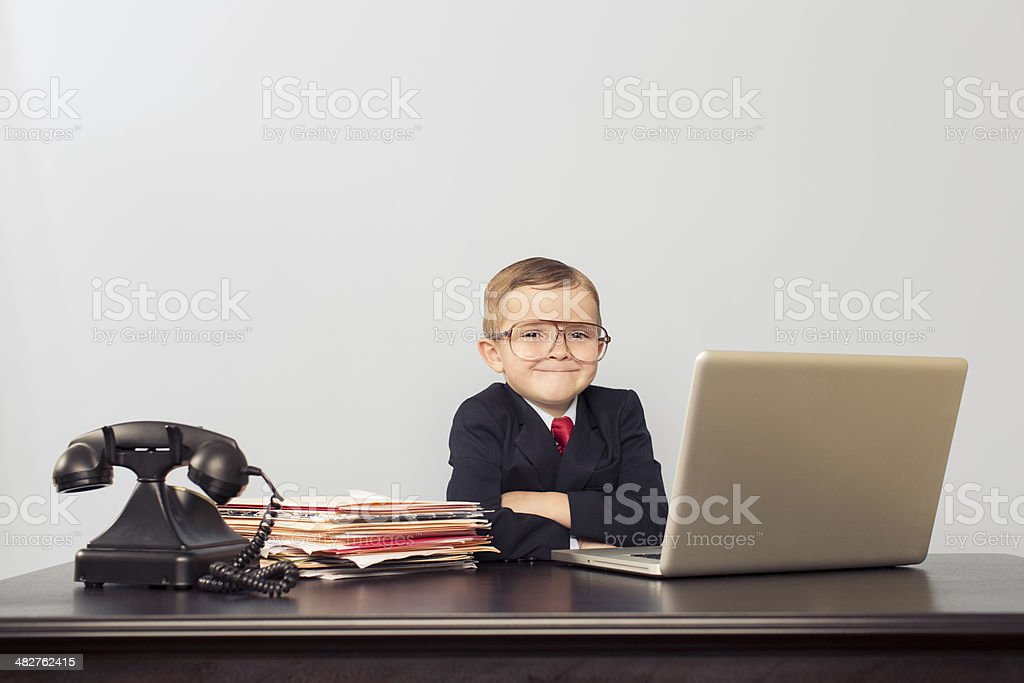 Young Boy Financial Advisor at Laptop stock photo