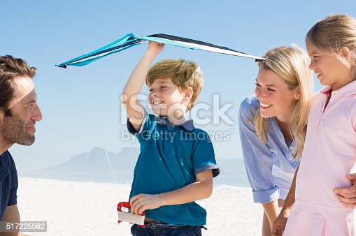 453383283 istock photo Young boy flying kite 517225562