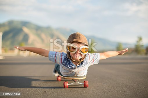 istock Young Boy Flying on Skateboard 1135837964
