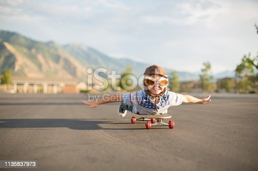 istock Young Boy Flying on Skateboard 1135837973
