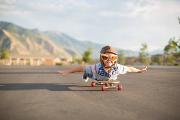 Young Boy Flying on Skateboard stock photo