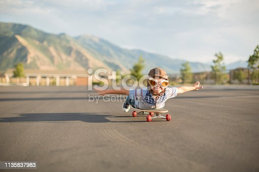 istock Young Boy Flying on Skateboard 1135837983