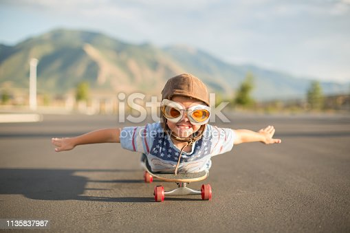 istock Young Boy Flying on Skateboard 1135837987