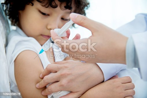 Young boy getting a vaccine.