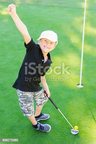 istock Young Boy Golfer Celebrating During Sunset 636275580