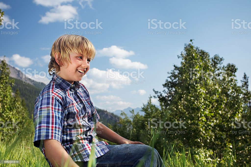 Young boy hanging out stock photo