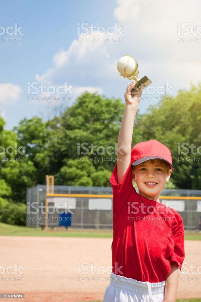 Young Boy Happy Holding Baseball Trophy stock photo