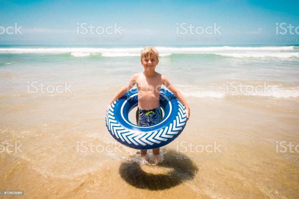 Young Boy Having Fun In The Ocean stock photo
