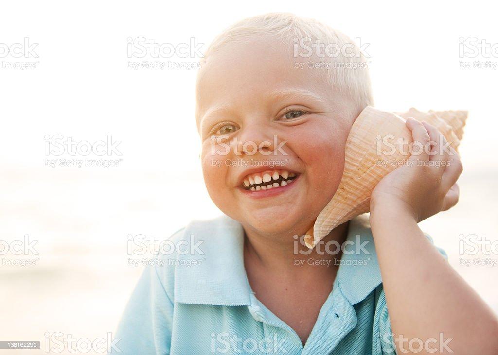 Young Boy having Fun on a Beach royalty-free stock photo