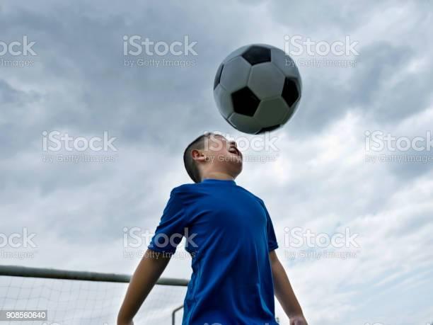 Young boy heading the ball picture id908560640?b=1&k=6&m=908560640&s=612x612&h=sbjvuab45pqopqg5vc0g66nlwgcvb2b mkeddziwci0=