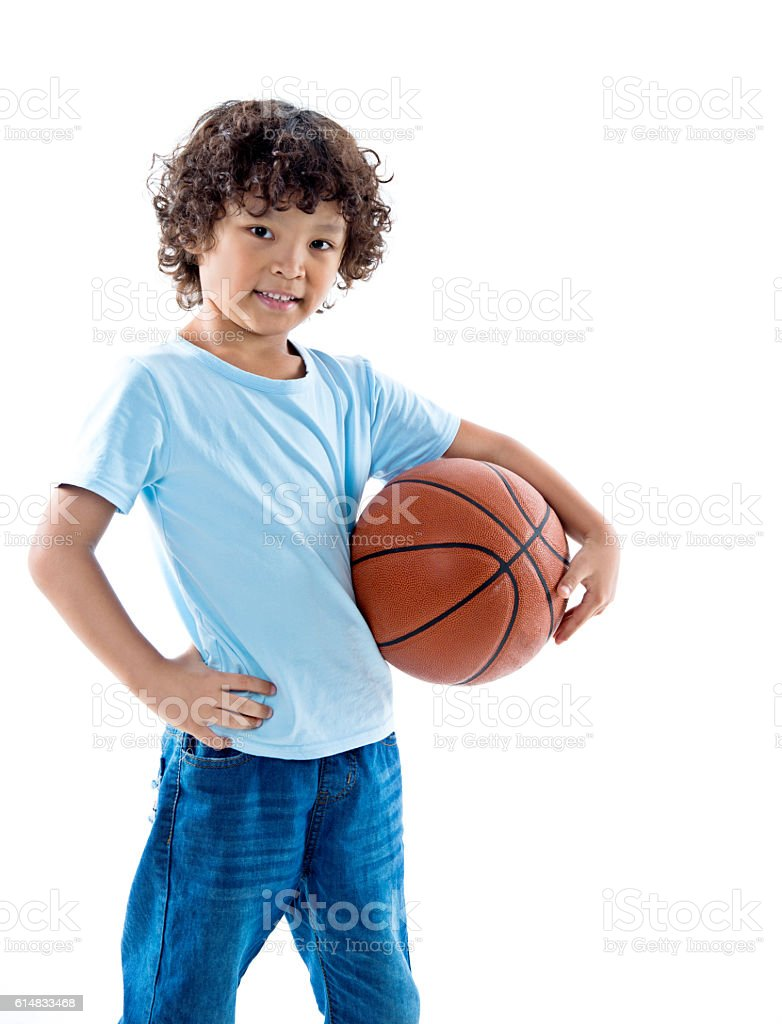 Young boy holding a basketball against white background – Foto
